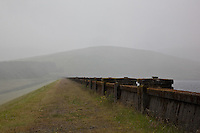 Dam at Daer Reservoir in the rain, Southern Uplands, Scotland