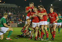 Wales U20's Kieran Williams, second left, is mobbed by teammates after scoring his side's fourth try<br /> <br /> Photographer Alex Dodd/CameraSport<br /> <br /> RBS Six Nations U20 Championship Round 4 - Wales U20s v Ireland U20s - Saturday 11th March 2017 - Parc Eirias, Colwyn Bay, North Wales<br /> <br /> World Copyright &copy; 2017 CameraSport. All rights reserved. 43 Linden Ave. Countesthorpe. Leicester. England. LE8 5PG - Tel: +44 (0) 116 277 4147 - admin@camerasport.com - www.camerasport.com