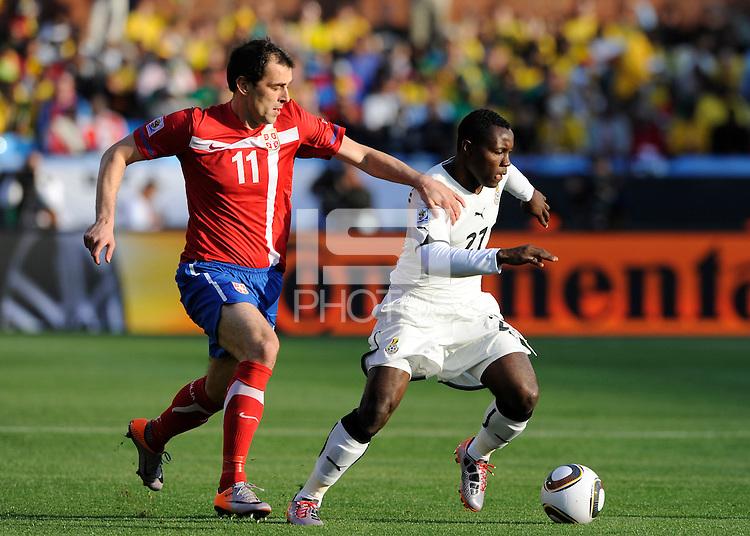 Kwadwo Asamoah of Ghana and Nenad Milijas of Serbia