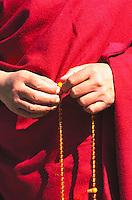 The Dalai Lama's hands.