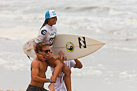 "BURLEIGH HEADS, Queensland/Australia (Saturday, 29 January, 2012) Alessa Quizon (HAW). – Caio Ibelli (BRA) and Leila Hurst (HAW) have claimed the Men's and Women's ASP World Junior Titles at the Billabong World Junior Championships today. The pair join a prestigious list of former ASP World Junior Champions, including: Adriano De Souza (BRA), Joel Parkinson (AUS), Andy Irons (AUS), Jessi Miley-Dyer (AUS) and Sally Fitzgibbons (AUS). ..Wade Carmichael (AUS) and Alessa Quizon (HAW) were also amongst the winners today, taking out the third and final event of the ASP World Junior Title Series, the Billabong ASP World Junior Championships...The Men's ASP World Junior Title race saw all the frontrunners bow out early today with Jack Freestone (AUS) eliminated by Medi Veminardi (REU) and Ian Gouveia (BRA) taken out by Wade Carmichael (AUS) in the Quarterfinals. Carmichael had a sensational outing at Burleigh Heads this week, gaining entry into the event with a win at the Von Zipper trials and then sticking it to the world's best junior surfers with a win at the Billabong ASP World Junior Championships...Another frontrunner, Garrett Parkes (AUS), needed to advance out of today's Quarterfinals to clinch the 2011 ASP World Junior Title, but was halted by South American sensation Filipe Toledo (BRA). Parkes's ousting in the Quarterfinals resulted in a tie with Caio Ibelli (BRA) for the top spot on the ASP World Junior Title rankings, requiring a ""Surf-Off"" to determine the champion...Caio Ibelli (BRA) started the Surf-Off with a couple of minor scores, it was clear that he was going for something big. Garret Parkes (AUS) on the other hand started chipping away at the lead, posting some scores in the good range to give him an early lead. Ibelli found a wave that linked up and unleashed some solid carves and a massive air-reverse to score an 8.67 (out of a possible 10), to swing momentum his way and take the lead. Parkes had a last minute chance to claim the pr"