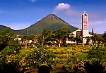 The Park And Church In The Tourist Town Of La Fortuna In Costa Rica Are Dominated By A Smoking Arenal Volcano.