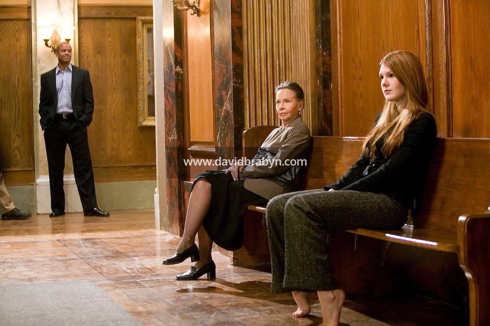 """8 May 2006 - North Bergen, NJ - French actress Leslie Caron (C) waits between takes with actress Lily Rabe (R) and extras on the studio set of television show """"Law & Order: SVU"""" in North Bergen, USA, 8 May 2006. In this rare appearance in front of American television cameras, Caron, 74, plays a French victim of past sexual molestation in an episode entitled """"Recall"""" due to air in the fall. Caron starred in Hollywood classics such as """"An American in Paris"""" (1951), """"Lili"""" (1953), """"Gigi"""" (1958). More recently she appeared in """"Chocolat"""" (2000) and """"Le Divorce"""" (2003). Photo Credit: David Brabyn"""