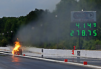May 14, 2016; Commerce, GA, USA; NHRA top fuel driver Chris Karamesines suffers an engine fire during qualifying for the Southern Nationals at Atlanta Dragway. Mandatory Credit: Mark J. Rebilas-USA TODAY Sports