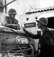 Lt. Col. Lyle Bernard, CO, 30th Inf. Regt., a prominent figure in the second daring amphibious landing behind enemy lines on Sicily's north coast, discusses military strategy with Lt. Gen. George S. Patton.  Near Brolo.  1943.   (Army)<br /> Exact Date Shot Unknown<br /> NARA FILE #:  111-SC-246532<br /> WAR &amp; CONFLICT BOOK #:  1024