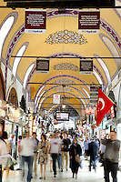 General view through Grand Bazaar, 15th century, Istanbul, Turkey. The Grand Bazaar, containing two bedestens (storage domes) is one of the largest and oldest covered markets in the world, selling jewellery, pottery, spice, and carpets. It was restored in the 16th and 19th centuries. Picture by Manuel Cohen.