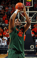 CHARLOTTESVILLE, VA- JANUARY 7: Reggie Johnson #42 of the Miami Hurricanes handles the ball during the game against the Virginia Cavaliers on January 7, 2012 at the John Paul Jones Arena in Charlottesville, Virginia. Virginia defeated Miami 52-51. (Photo by Andrew Shurtleff/Getty Images) *** Local Caption *** Reggie Johnson