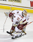 Cam Atkinson (BC - 13), John Muse (BC - 1) - The Boston College Eagles defeated the visiting University of New Hampshire Wildcats 4-0 while celebrating senior night on Friday, March 4, 2011, at Conte Forum in Chestnut Hill, Massachusetts.