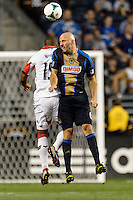 Conor Casey (6) of the Philadelphia Union goes up for a header with Ethan White (15) of D. C. United. The Philadelphia Union defeated D. C. United 2-0 during a Major League Soccer (MLS) match at PPL Park in Chester, PA, on August 10, 2013.