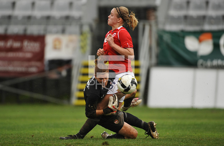 Nicole Barnhart, goalie for the US National Team, collides with a Norwegian attacker in a game vs Norway during the 2010 Algarve Cup.