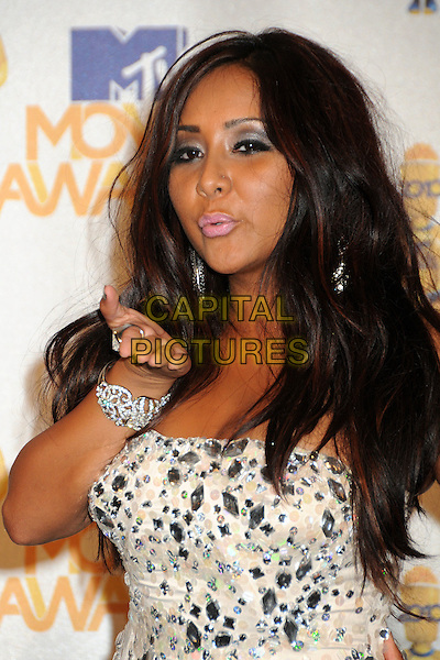 SNOOKI (Nicole Polizzi) of Jersey Shore.MTV Movie Awards 2010 - Press Room held at the Gibson Amphitheatre, Universal City, California, USA..June 6th, 2010.half length jewel gem encrusted strapless cream white silver sparkly make-up eyeshadow shiny tanned hand blowing kiss.CAP/ADM/BP.©Byron Purvis/AdMedia/Capital Pictures.