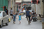 People on a street in the Zeitoun neighborhood of Gaza City, Gaza. Residents of the Palestinian territory are still reeling from the death and destruction of the 2014 war with Israel, and the continuing siege of the seaside territory by the Israeli military.
