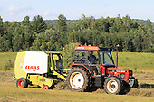 Bailing round bales of hay, Quebec Canada