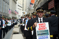 United and Continental pilots conduct an informational picket outside the New York Stock Exchange on Tuesday, September 27, 2011 on the eve of the one-year anniversary of the corporate merger. The pilots, represented by ALPA, are protesting the pace of their collective bargaining negotiations.  (© Frances M. Roberts)
