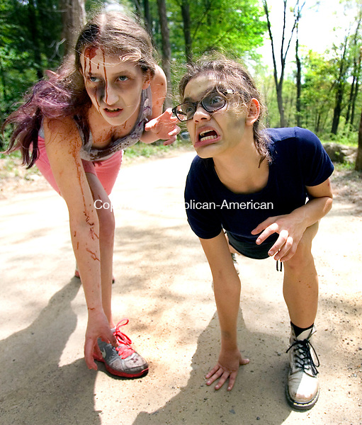 WASHINGTON CT. 09 May 2015-050915SV10-From left, Dallas Miller, 18, of New Milford, and Emily Alworth, 17, of Roxbury wait to chase down runners during the 5K Zombie Run Against Epilepsy at the Steep Rock Preserve in Washington Depot Saturday.<br /> Steven Valenti Republican-American