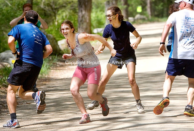WASHINGTON CT. 09 May 2015-050915SV12-From left, Dallas Miller, 18, of New Milford, and Emily Alworth, 17, of Roxbury chase down runners during the 5K Zombie Run Against Epilepsy at the Steep Rock Preserve in Washington Depot Saturday.<br /> Steven Valenti Republican-American