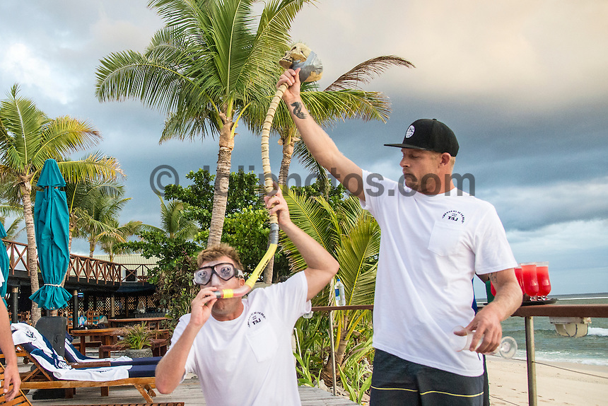 Namotu Island Resort, Nadi, Fiji (Monday, June 6 2016): Taj Burrow (AUS) and Mick fanning (AUS) doing a Skull Drag to get Taj's party started. The Fiji Pro, stop No. 5 of 11 on the 2016  WSL Championship Tour, witnessed heated head-to-head match-ups as the world's best surfers fought through elimination Round 2 in four-to-six foot (1 - 2 metre) waves at Cloudbreak. Round Two was completed with the new longer period swell from the West slowly dropping during the day.  The contest was looking at a number of lay-days due to the  dropping swell so it gave the surfers on Namotu a chance to celebrate Taj Burrow's birthday and his retirement.  Photo: joliphotos.com