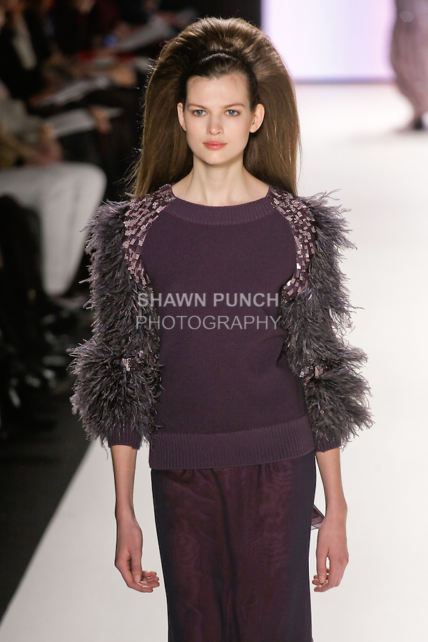 Bette Franke walks runway in an imperial purple layered silk chiffon skirt, imperial purple crew neck sweater with embroidered and feathered sleeves, from the Carolina Herrera Fall 2012 collection, during Mercedes-Benz Fashion Week Fall 2012 in New York.