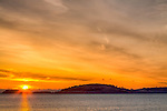 Sunrise over the Boston Harbor Islands seen from Pleasure Bay, South Boston, Massachusetts, USA
