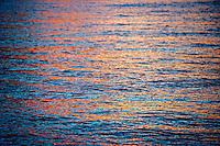 Sunset light dances across the ocean off of Kauai.