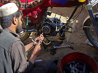 A local mechanic services the Taliban bikes. These mechanics are mobile and can move out to combat positions to service bikes in the field if needed