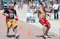 Members of Fight Fitness La train at Santa Monica?s Muscle Beach on Sunday, June 10, 2012.