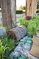 """""""After The Fall"""" by Jack Chandler at Late Show Gardens with recycled plastic bottles and 55 gallon drum"""