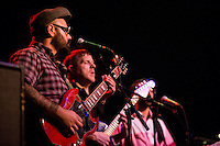 Marcos Garcia (left) and Luke O'Malley play guitar for Antibalas  at Union Transfer in Philadelphia on December 13, 2012.