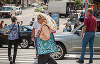 """Pedestrians cross Broadway at West 96th Street in New York on Monday, August 4, 2014. As part of Mayor Bill de Blasio's """"Vision Zero"""" initiative the speed limit of 30 mph has been reduced to 25 mph. Broadway from West 59th Street to West 220 Street has been posted as a """"Slow Zone"""". with the other """"Slow Zone"""" starting today atSouthern Blvd. in the Bronx. Two dozen zones will be instituted in the five boroughs over the course of several months. 22 pedestrians have been killed since 2008 in the Broadway """"Slow Zone"""" and speeding is the top cause of traffic injuries and fatalities.   (© Richard B. Levine)"""