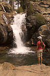 Woman hiker checking out a swimming hole on Canyon Creek, Tahoe National Forest California