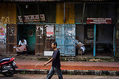 A pedestrian walks past the Communist party offices in Kochi, Kerala, India.