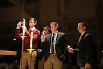 Delta Sigma Phi fraternity brothers light the first candles at the Candlelight Vigil for Alex Ehr in the Newman Center in Lexington, Ky., on 2/23/12. Photo by Brandon Goodwin | Staff