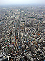 October 30, 2011, Tokyo, Japan - The landscape of metropolitan Tokyo spreads below the main observation deck of Tokyo Sky Tree on Sunday, October 30, 2011. The main observation deck of the terrestrial digital broadcasting tower was for the first time opened to the media. The three-story structure at 350 meters above the ground houses a restaurant, souvenir shop and an observation deck on the top floor. The tower begins its operation on May 22, 2012. (Photo by Natsuki Sakai/AFLO) [3615] -mis-