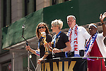10 July 2015: Carli Lloyd (left) and Megan Rapinoe (2nd from left, holding the WWC Championship Trophy). The United States Women's National Team was honored with a parade down New York City's Canyon of Heroes for winning the FIFA 2015 Women's World Cup in Canada.