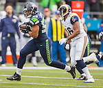 Seattle Seahawks linebacker Malcolm Smith (53) returns  St. Louis Rams Kellen Clemens pass interception 37 yards for a touchdown in the first quarter at CenturyLink Field in Seattle, Washington on December 29, 2013.   ©2013. Jim Bryant Photo. ALL RIGHTS RESERVED.