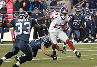 27 Nov 2005:   New York Giants wide receiver Plaxico Buress breaks free from Seattle Seahawks linebacker Lofa Tatupu #51 for a first down at Quest Field in Seattle, WA.