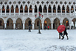 VENICE, ITALY - DECEMBER 17:  Tourists walks in St Mark Square covered with snow on December 17, 2010 in Venice, Italy. Snow has fallen across much of Europe today and is expected to continue over the weekend, causing traffic chaos and disrupting Christmas deliveries.