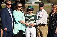 HOT SPRINGS, AR - MARCH 18: Jockey Mike Smith accepts the Essex Handicap trophy in winners circle after winning the Essex Handicap race at Oaklawn Park on March 18, 2017 in Hot Springs, Arkansas. (Photo by Justin Manning/Eclipse Sportswire/Getty Images)
