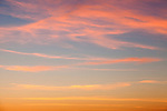 Multi-colored cirrus clouds at sunset in Malibu, California, USA