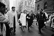 December 1967, Manhattan, New York City, New York State, USA --- New York Governor Nelson Rockefeller and his wife Happy Rockefeller walk down Madison Avenue followed by security and the press. --- Image by © JP Laffont