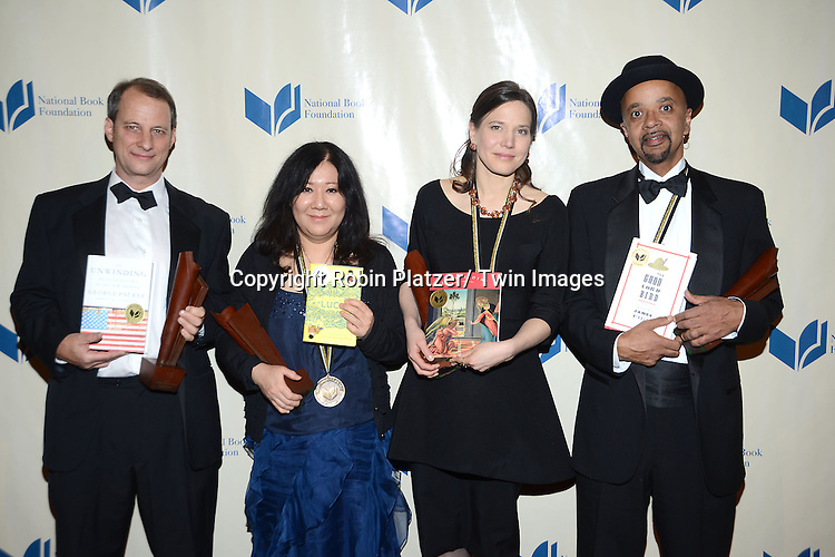 The winners, George Packer, Cynthia Kadohata, Mary Szybist and James McBride attend the 2013 National Book Awards Dinner and Ceremony on November 20, 2013 at Cipriani Wall Street in New York City.