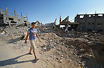 A boy walks through Shejaiya, a Gaza neighborhood which bore the brunt of some of the most intense Israeli air attacks during the 2014 war. Throughout Gaza, members of the ACT Alliance are supporting health care, vocational training, rehabilitation of housing and water systems, psycho-social care, and a variety of other humanitarian activities.