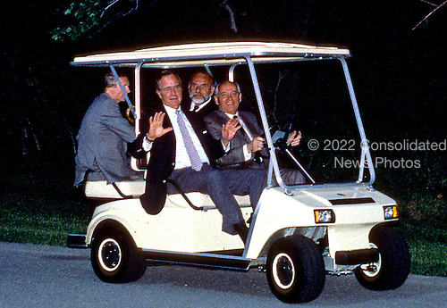 Camp David, Maryland - June 2, 1990 -- United States President George H.W. Bush shows no fear as Soviet President Gorbachev drives a golf cart for the first time at Camp David, Maryland on June 2, 1990..Credit: Ron Sachs / CNP