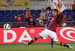 Calcio, Serie A: Roma vs Sampdoria. Roma, stadio Olimpico, 26 settembre 2012..Sampdoria forward Eder, of Brazil, kicks the ball as AS Roma defender Leandro Castan, also of Brazil, right, challenges him during the Italian Serie A football match between AS Roma and Sampdoria at Rome's Olympic stadium, 26 September 2012..UPDATE IMAGES PRESS/Riccardo De Luca