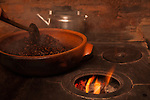A wood fire stove with coffee beans in a ceramic roaster at the Old Mill House Coffee Experience, Santa Catarina, Brazil