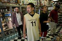 Two members of the Far East Ballers, a Japanese street basketball team, break from practice on a court on 43rd street in New York City, USA, to buy drinks a food from a deli, June 19 2005.