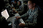 Multi-source intelligence analyst Tech Sergeant Tim Anderson works on the operations floor at Beale Air Force Base in Linda, Calif., April 7, 2010.