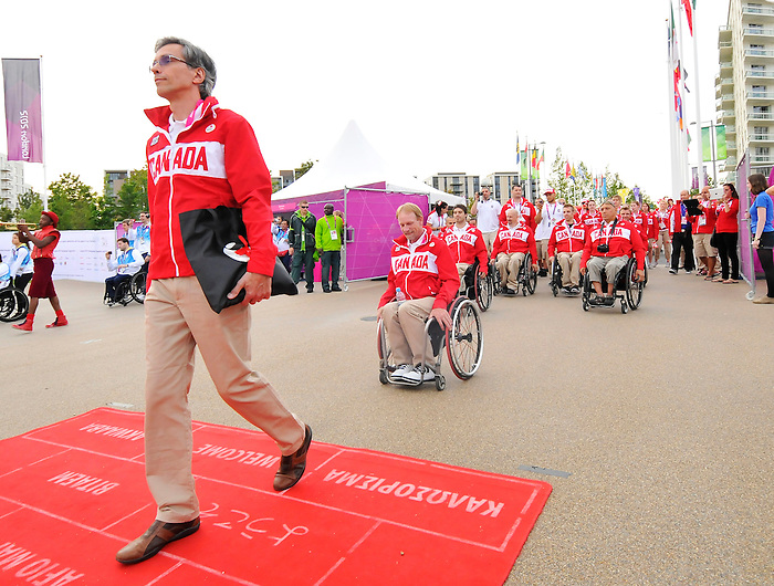LONDON, ENGLAND – 08/26/2012:  Gaetan Tardif lead Canada into the Flag Raising Ceremony at the London 2012 Paralympic Games. (Photo by Matthew Murnaghan/Canadian Paralympic Committee)