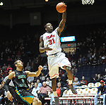 "Mississippi's Murphy Holloway (31) scores against Coastal Carolina's Warren Gillis (0) at the C.M. ""Tad"" Smith Coliseum in Oxford, Miss. on Tuesday, November 13, 2012. (AP Photo/Oxford Eagle, Bruce Newman)"