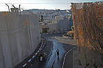 Ultra-Orthodox Jews walk at the compound of Rachel's Tomb, in the outskirts of Bethlehem, West Bank. The place is believed by Jews to be the burial place of the biblical matriarch Rachel, and the structure sits in a heavily protected compound, between Bethlehem and Jerusalem.